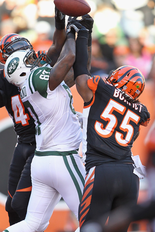 . Vontaze Burfict #55 of the Cincinnati Bengals battles for the football with Jeff Cumberland #87 of the New York Jets during their game at Paul Brown Stadium on October 27, 2013 in Cincinnati, Ohio.  The Bengals defeated the Jets 49-9.  (Photo by John Grieshop/Getty Images)