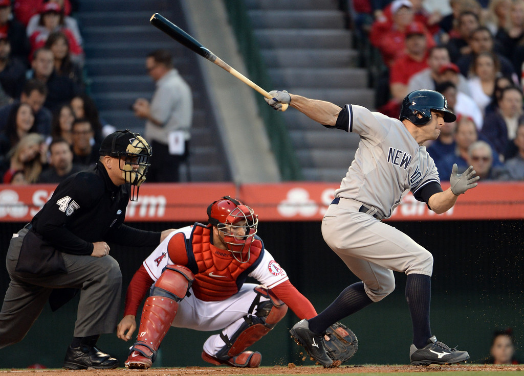 . New York Yankees\' Brett Gardner hits a ground ball that Los Angeles Angels starting pitcher Hector Santiago (not pictured) threw away for a error in the first inning of a baseball game at Anaheim Stadium in Anaheim, Calif., on Wednesday, May 7, 2014.  (Keith Birmingham Pasadena Star-News)