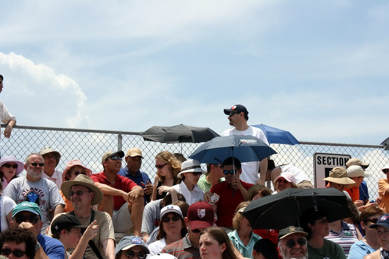 The VIP bleachers at the Banana Creek viewing area.   The umbrellas are for shade, not rain.