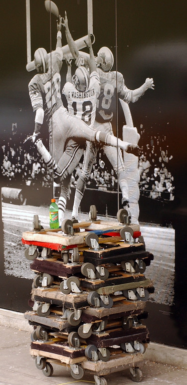 . Moving carts sit in front of a Detroit Lions mural at the Lions Pontiac Silverdome office. After playing 30 miles north of Detroit for 27 years, the Lions will return downtown next season to plat at Frod Field, a new $315 million indoor venue that will host the 2006 Super Bowl.