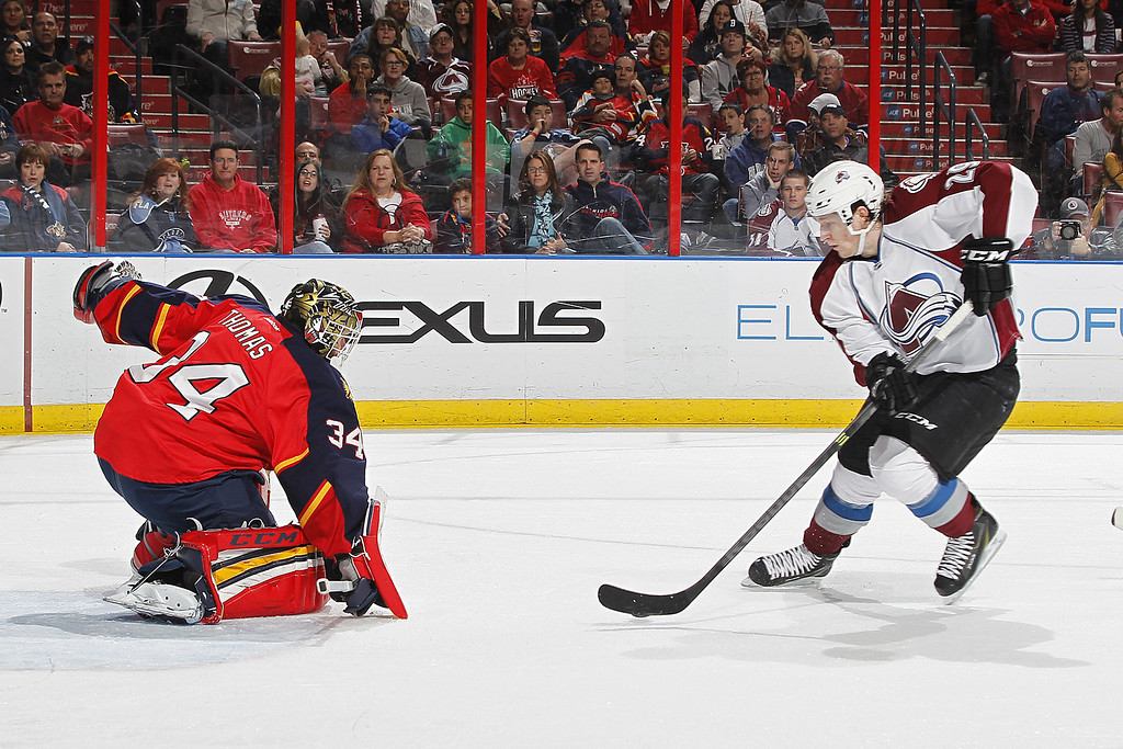 . SUNRISE, FL - JANUARY 24: Goaltender Tim Thomas #34 of the Florida Panthers stops a second period shot by Nathan MacKinnon #29 of the Colorado Avalanche at the BB&T Center on January 24, 2014 in Sunrise, Florida. (Photo by Joel Auerbach/Getty Images)