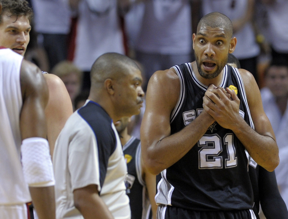 . Tim Duncan (R) of the San Antonio Spurs reacts to a call in the first half during Game 1 of the NBA Finals against the Miami Heat on June 6, 2013 at American Airlines Arena in Miami, Florida.   BRENDAN SMIALOWSKI/AFP/Getty Images