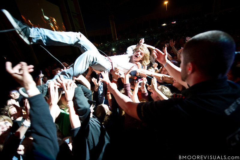 "Matthew Schultz of Cage The Elephant greets the fans with a stage dive during the band's performance in support of their upcoming album, ""Thank You, Happy Birthday"" on December 5, 2010 during 97X Next Big Thing at 1-800-ASK-GARY Amphitheatre in Tampa, Florida"