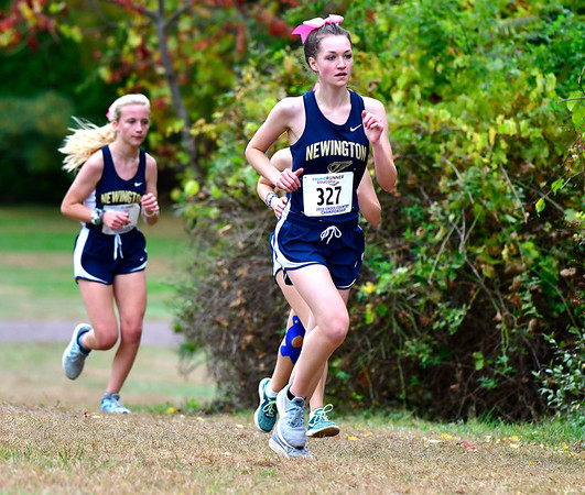 10/16/2019 Mike Orazzi | Staff Newington High School's Julie Robinson (327) during the girls CCC XC Championship held at Wickham Park in Manchester on Wednesday.