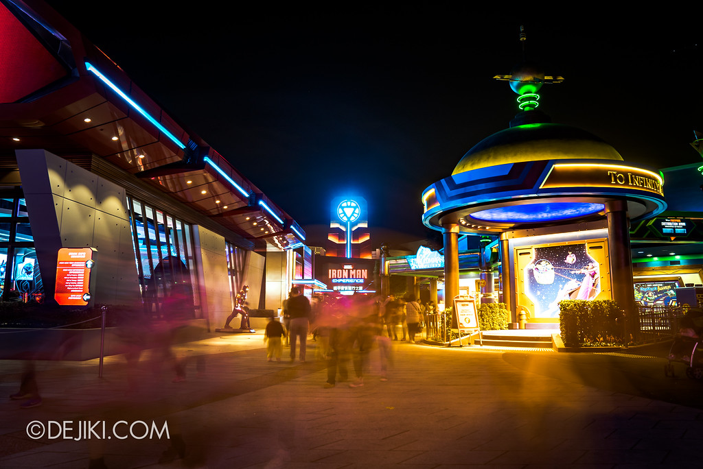 Hong Kong Disneyland Buzz Lightyear Astro Blasters Last Mission - Tomorrowland at night showing Iron Man experience in the distance