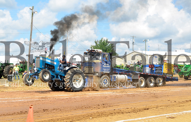 Some tractors rear up on their back wheels when pulling a heavy weight in tractor pull competitions. -Tanner Cole