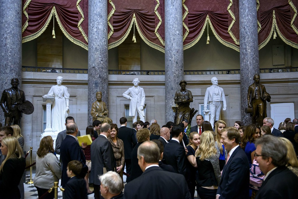 . Members of Congress and their loved ones wait in line in Statuary Hall for a mock swearing-in ceremony on Capitol Hill January 6, 2015 in Washington, DC. The 114th Congress convened today with Republicans taking majority control of both the Senate and House of Representatives. Republican John Boehner was re-elected and sworn in Tuesday as speaker of the US House of Representatives, overcoming a surprisingly robust attempt to oust him by two dozen hardcore conservatives. Boehner received 216 of the 408 votes cast in the chamber, winning as expected over Democrat leader and former House speaker Nancy Pelosi, who received 164 votes. BRENDAN SMIALOWSKI/AFP/Getty Images