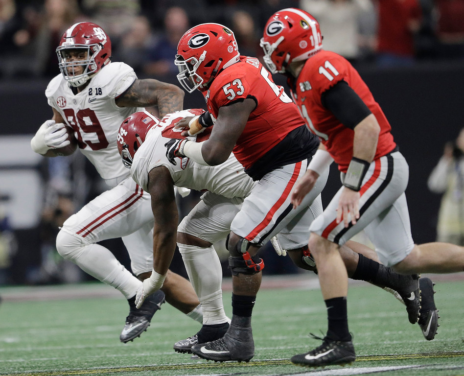 . Alabama\'s Raekwon Davis runs back an interception during the second half of the NCAA college football playoff championship game against Georgia Monday, Jan. 8, 2018, in Atlanta. (AP Photo/David J. Phillip)