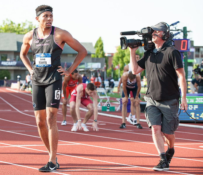 Isaiah Harris looks up at the giant screen to see his time after winnning his heat and advancing to the finals of the D1 Track and Field Championship race in Eugene, Oregon Wednesday night.  (Russ Dillingham/Sun Journal)