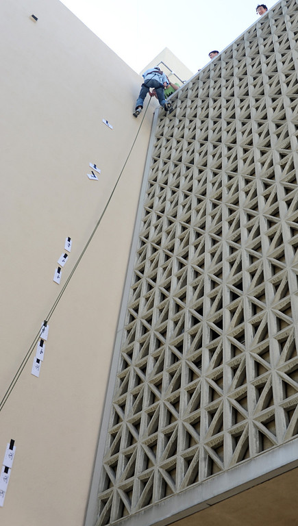 . Eli Alster, a Caltech student repelling off Firestone Laboratory picking up clues that have been attached to the building for Pixar Stack. Caltech students looking for clues in letters in letter combinations during Ditch Day.A fun-filled day of antics and escapades, Ditch Day is one of Caltech�s oldest traditions � a cross between Animal House and a science fair! Friday, May 24, 2013. Caltech seniors ditch their classes while underclassmen devote their entire day to quirky pranks and attempting to solve elaborate puzzles, mazes, quests, and other challenging hijinks that seniors have devised and left behind for them.This year�s activities include a laser maze, sledgehammer brick building demolition, shopping cart race, sumo tournament, roof rappelling, hovercraft human bowling, teleportation and time-travel puzzles, and much more.(SGVN/Photo by Walt Mancini)
