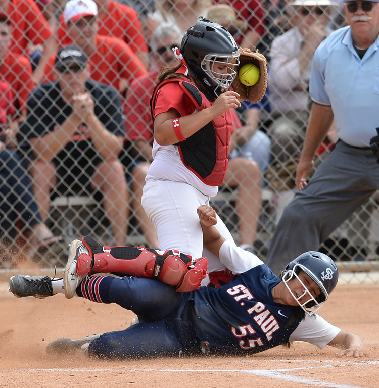 . Palos Verdes catcher Allison Benitez (17) doesn\'t get the throw in time at home as St. Paul\'s Myranda Bueno (55) slides in under her in a CIF-SS Division III semifinal softball game Tuesday, May 27, 2014, Palos Verdes Estates, CA.   Palos Verdes lost 10-0. Photo by Steve McCrank/Daily Breeze