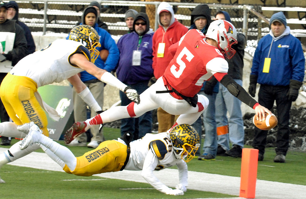 . Maribeth Joeright/MJoeright@News-Herald.com<p>  Mentor\'s Conner Krizancic leaps into the end zone for a touchdown during the first quarter of the Division I state final game against Archbiship Moeller, Saturday, in Canton.