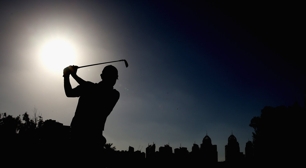 . Stephen Gallacher of Scotland plays his second shot on the par five 18th hole during the final round of the Omega Dubai Desert Classic on February 3, 2013 in Dubai, United Arab Emirates.  (Photo by Ross Kinnaird/Getty Images)