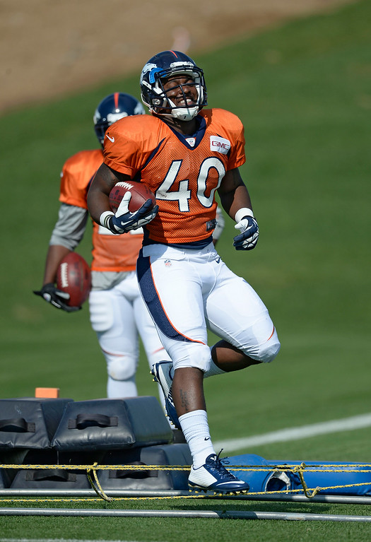 . Denver Broncos running back Juwan Thompson (40) runs through drills on day five of the Denver Broncos 2014 training camp July 28, 2014 at Dove Valley. (Photo by John Leyba/The Denver Post)