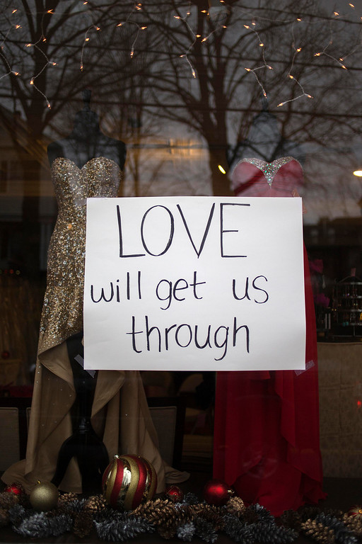 . A sign for victims of the Sandy Hook Elementary shooting hangs in the window of a women\'s dress shop in Newtown, Connecticut December 16, 2012. Worshippers filled Sunday services to mourn the victims of a gunman\'s elementary school rampage that killed 20 children and six adults with President Barack Obama due to appear later at an interfaith vigil to help this shattered Connecticut town recover.   REUTERS/Adrees Latif