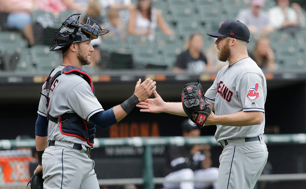 . Cleveland Indians catcher Yan Gomes, left, and relief pitcher Cody Allen celebrate the team\'s 5-2 win over the Chicago White Sox after a baseball game Thursday, June 14, 2018, in Chicago. (AP Photo/Charles Rex Arbogast)