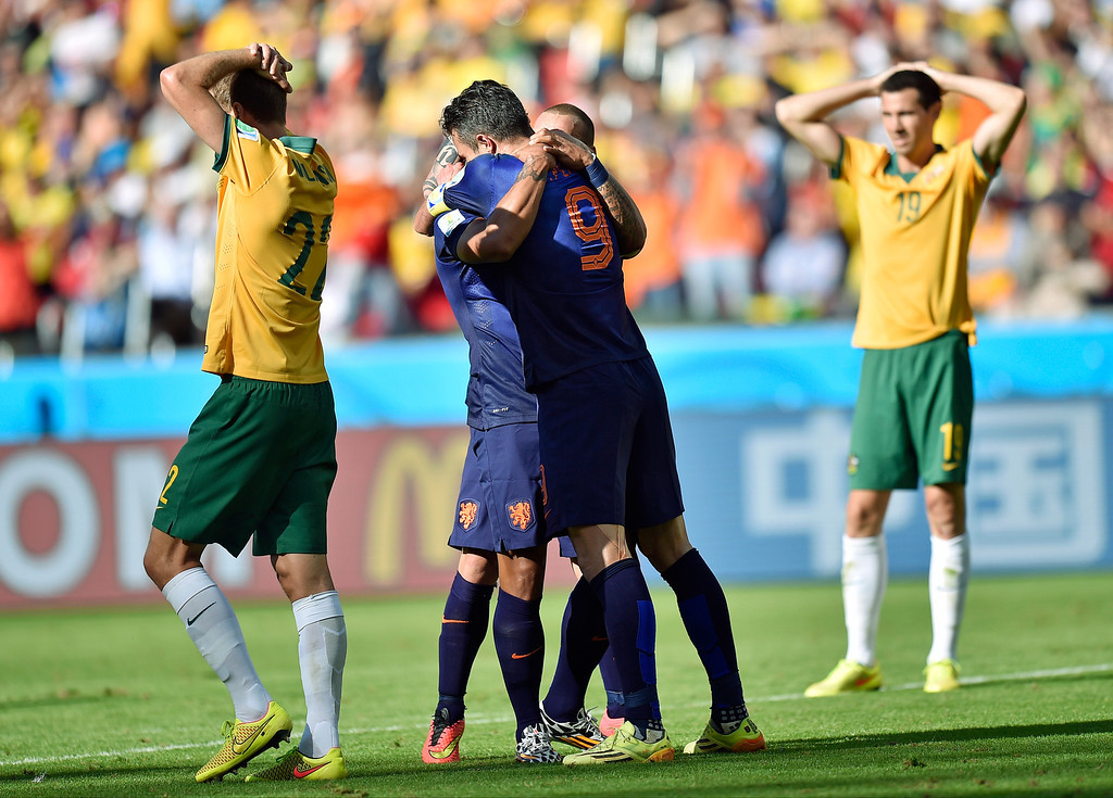 . Dutch players celebrate after Netherlands\' Memphis Depay scored his side\'s third goal during the group B World Cup soccer match between Australia and the Netherlands at the Estadio Beira-Rio in Porto Alegre, Brazil, Wednesday, June 18, 2014.    (AP Photo/Martin Meissner)