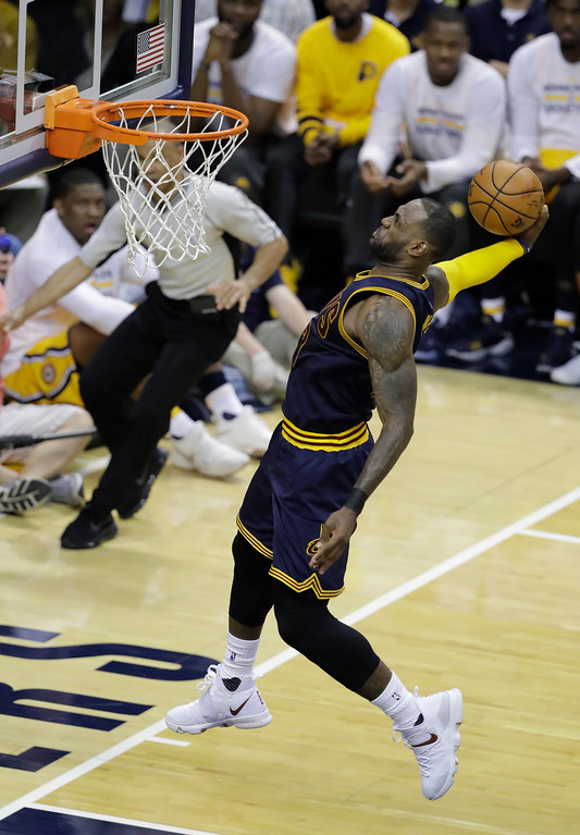. Cleveland Cavaliers\' LeBron James dunks during the second half in Game 3 of the first round of the NBA playoffs against the Indiana Pacers on April 20 in Indianapolis. Cleveland defeated Indiana 119-114, to lead the series 3-0. James led the Cavs in points (41), assists (12) and rebounds (13). (AP Photo/Darron Cummings)