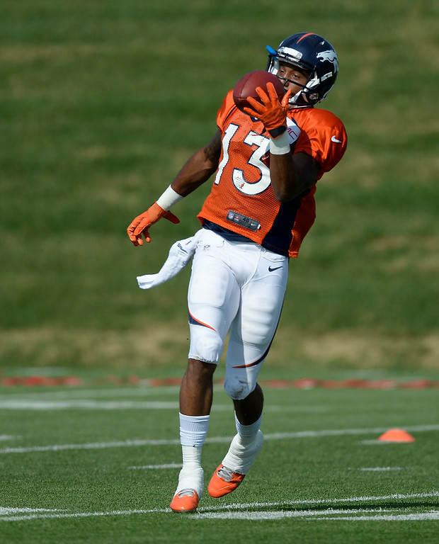 . Denver Broncos wide receiver Nathan Palmer (13) catches a pass during drills on day five of the Denver Broncos 2014 training camp July 28, 2014 at Dove Valley. (Photo by John Leyba/The Denver Post)