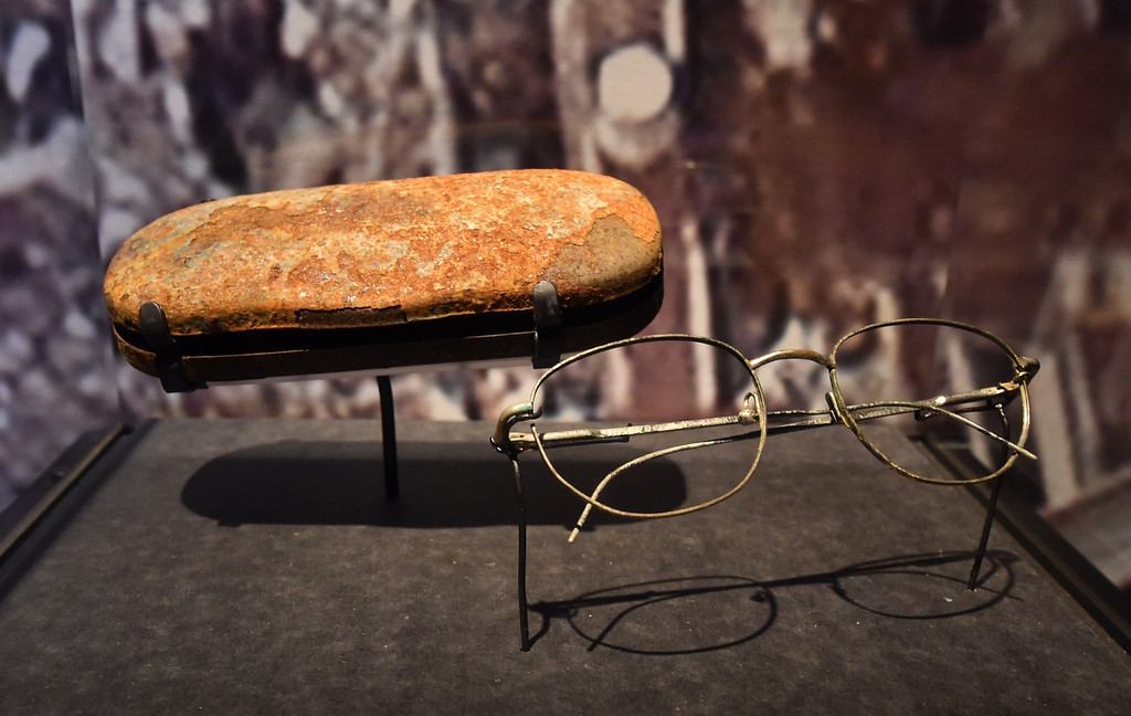 . Eyeglasses and a case found in the World Trade Center wreckage, seen during a press preview of the National September 11 Memorial Museum at the World Trade Center site May 14, 2014 in New York. AFP PHOTO/Stan HONDA/AFP/Getty Images