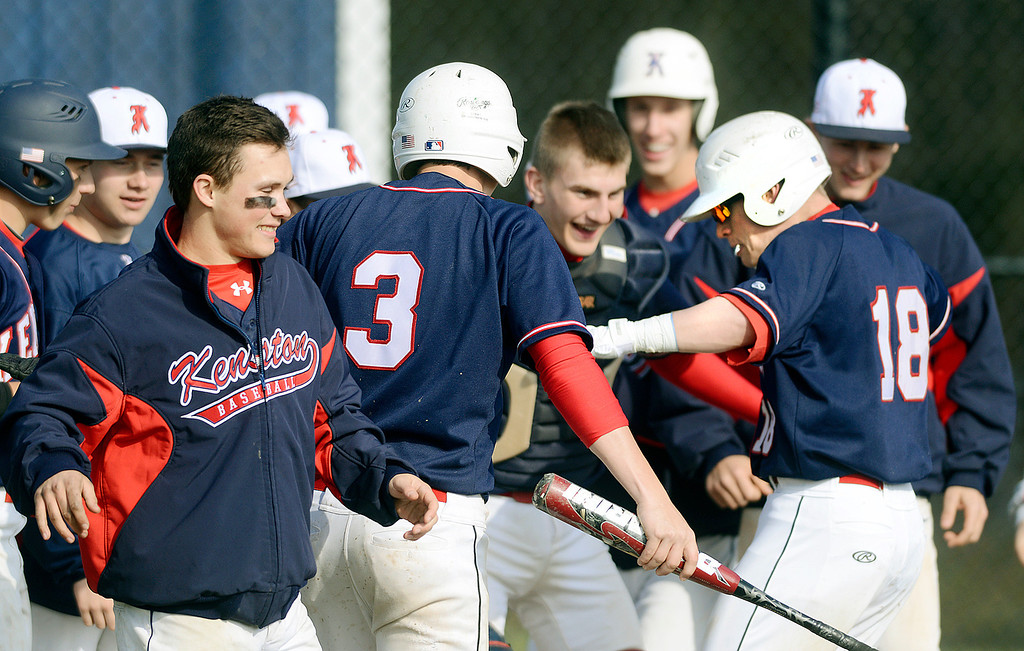 . Maribeth Joeright/MJoeright@News-Herald.com<p> Members of the Kenston baseball team surround Jake Silberman, right, as he crosses home plate after hitting a two run home run in the third inning against West Geauga High School, April 22, 2014. Kenston won by a score of 16-3.