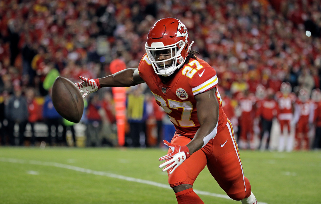 . Kansas City Chiefs running back Kareem Hunt (27) can\'t complete a catch during the first half of an NFL football game against the Los Angeles Chargers in Kansas City, Mo., Saturday, Dec. 16, 2017. (AP Photo/Charlie Riedel)
