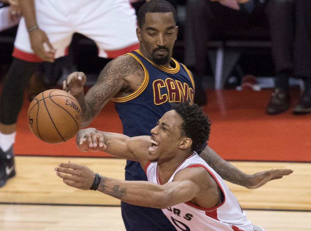 . Toronto Raptors\' Demar Derozan is fouled by Cleveland Cavaliers\' JR Smith during the first half of Game 3 of an NBA basketball second-round playoff series in Toronto on Friday, May 5, 2017. (Fred Thornhill/The Canadian Press via AP)
