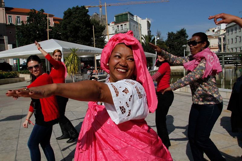 ". People dance during the ""One Billion Rising\"" event, a cause for fighting against violence on women in downtown Lisbon February 14, 2013. REUTERS/Hugo Correia"