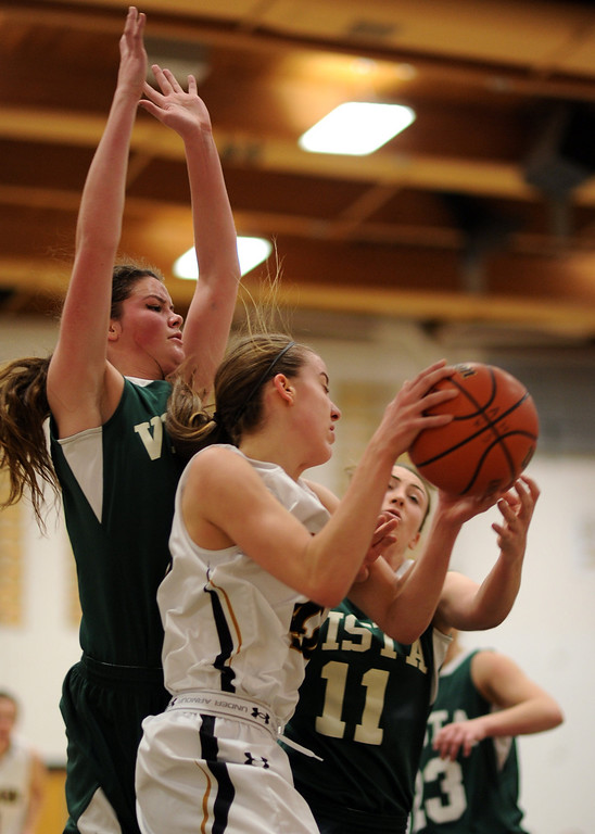 . Arapahoe\'s Mikaela Moore (40) controls the offensive rebound in the first half of the game against Mountain Vista at Arapahoe High School Gym onSaturday, Jan. 5, 2013, in Centennial, Colo. Arapahoe won 74-38. Hyoung Chang, The Denver Post