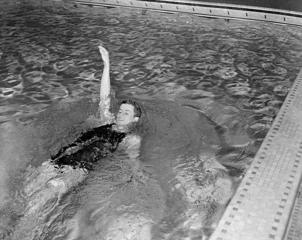 . Kennedy swims in the backstroke event for the varsity swimming team at Harvard on March 10, 1938.  Associated Press file