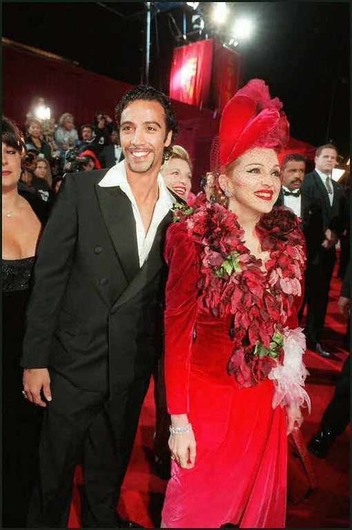 """. \""""Evita\"""" star Madonna and Carlos Leon, father of their infant daughter, arrive for the film\'s premiere Saturday, Dec. 14, 1996, at the Shrine Auditorium in Los Angeles.  (CHRIS PIZZELLO/AFP/GettyImages)"""