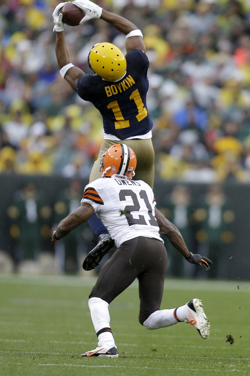 . Jarrett Boykins #11 of the Green Bay Packers makes the leaping catch during the first half of actionagainst the Cleveland Browns during the game at Lambeau Field on October 20, 2013 in Green Bay, Wisconsin. (Photo by Mike McGinnis/Getty Images)