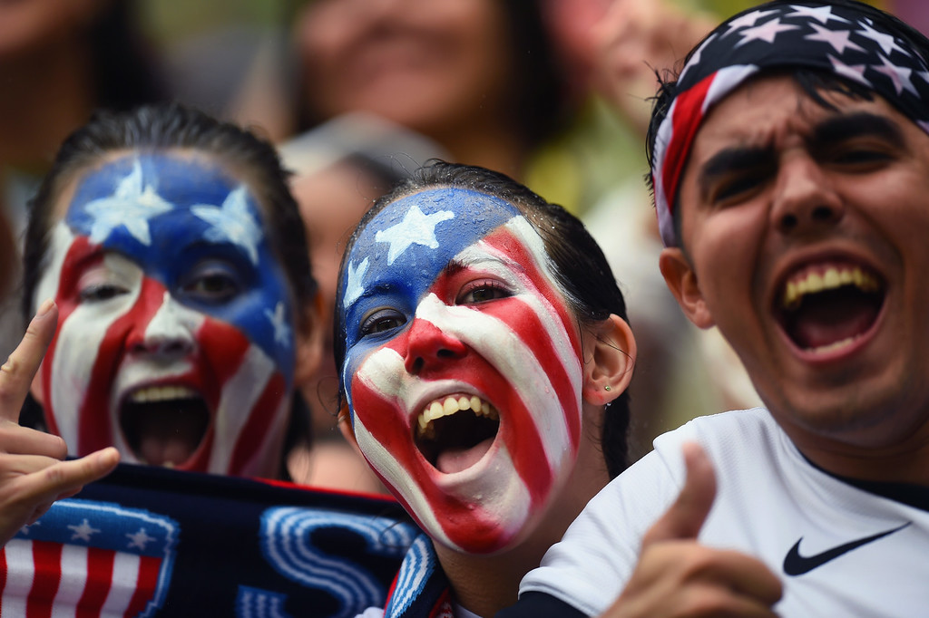 . United States fans cheer during the 2014 FIFA World Cup Brazil group G match between the United States and Germany at Arena Pernambuco on June 26, 2014 in Recife, Brazil.  (Photo by Jamie McDonald/Getty Images)