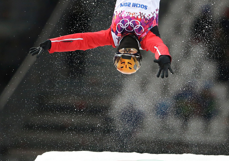 . China\'s Xu Mengtao makes her silver medal winning jump during the women\'s freestyle skiing aerials final at the Rosa Khutor Extreme Park, at the 2014 Winter Olympics, Friday, Feb. 14, 2014, in Krasnaya Polyana, Russia.(AP Photo/Sergei Grits)