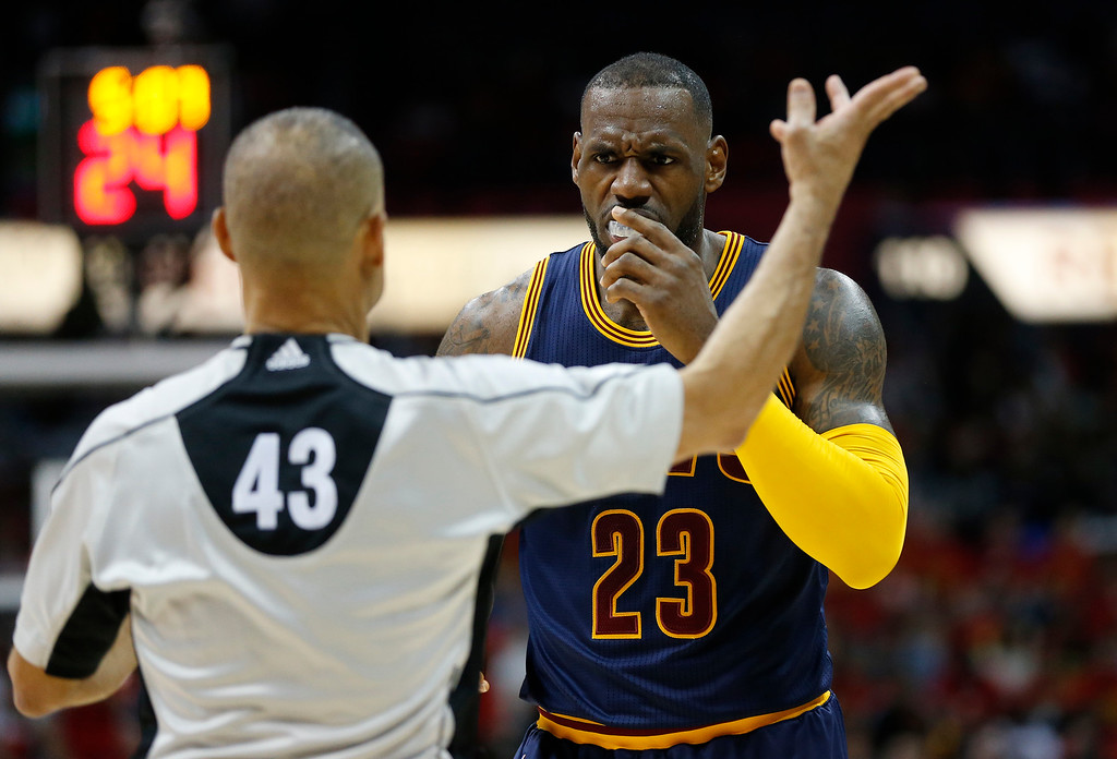 . Cleveland Cavaliers forward LeBron James (23) speaks to officials against the Atlanta Hawks in the first half of Game 3 of the second-round NBA basketball playoff series, Friday, May 6, 2016, in Atlanta. (AP Photo/John Bazemore)