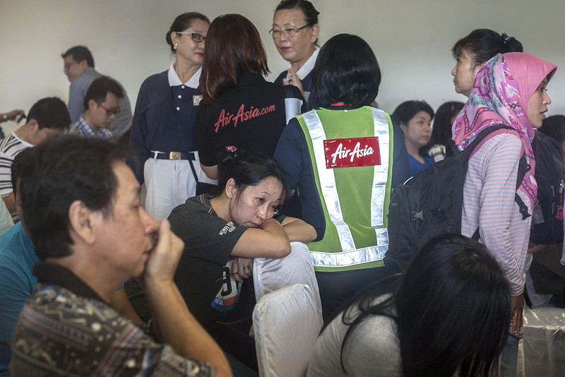 . Family members of passengers from missing Malaysian air carrier AirAsia flight QZ8501 gather at the airport in Surabaya, East Java, on December 29, 2014. The AirAsia plane which went missing with 162 people on board en route for Singapore is likely at the bottom of the sea, Indonesia\'s National Search and Rescue Agency chief said on December 29. JUNI KRISWANTO/AFP/Getty Images