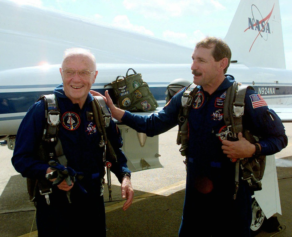 . Astronaut Curt Brown, right, talks about Astronaut and Sen. John Glenn\'s, D-Ohio, performance after a training flight Monday, Aug. 24, 1998, in Houston. Brown and Glenn are members of the space shuttle crew scheduled to fly  in October. (AP Photo/David J. Phillip)