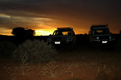 Sunset and the support vehicles at Camp III.