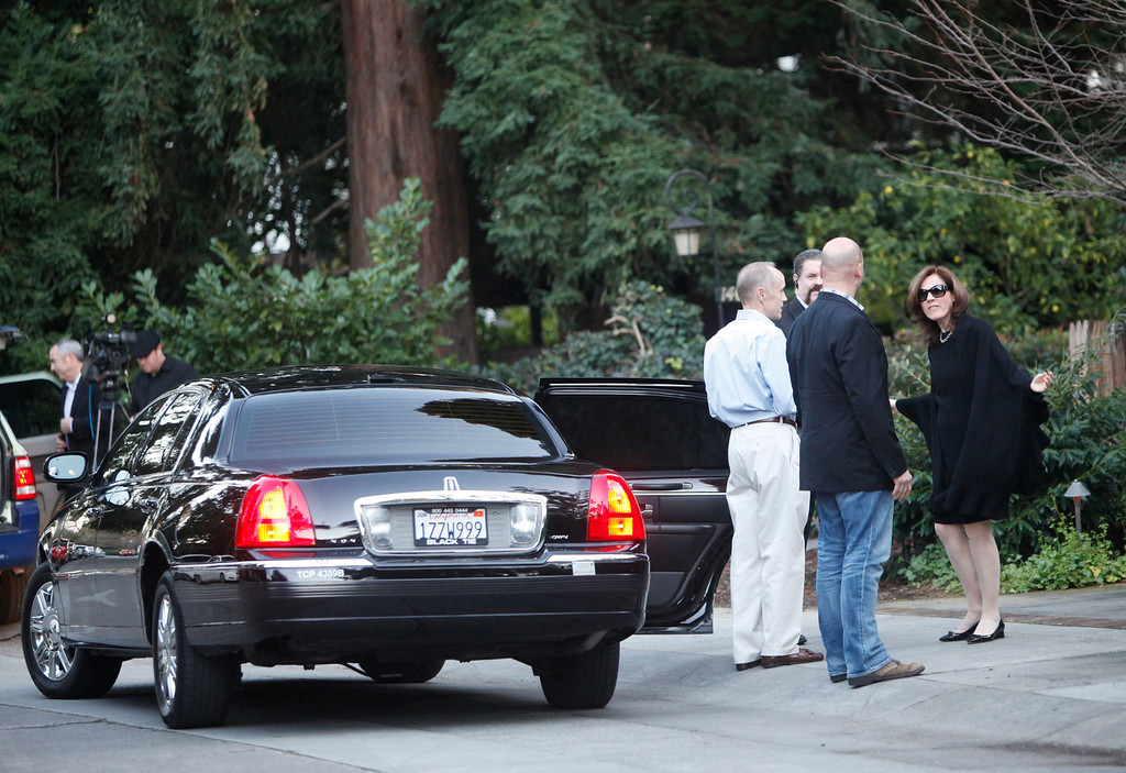 ". A guest arrives to a campaign fundraiser for New Jersey Republican Gov. Chris Christie walks past protesters standing in front of the home of Facebook CEO Mark Zukerberg in Palo Alto on Wednesday, Feb. 13, 2013. About 40 protesters rallied in front of the home, saying they objected to Christie�s visit because of his efforts to strip funding from Planned Parenthood and other women�s reproductive health care programs. Protester and Palo Alto resident Cheryl Lilienstein said she wondered whether Zuckerberg had any idea what Planned Parenthood means for women\'s health or what Christie�s stances are. ""I hope he\'s just confused,\"" she said. Zuckerberg and wife Priscilla Chan first got to know Christie after donating $100 million to struggling Newark, N.J., schools two years ago, according to a Facebook spokeswoman.   (Kirstina Sangsahachart/ Daily News)"