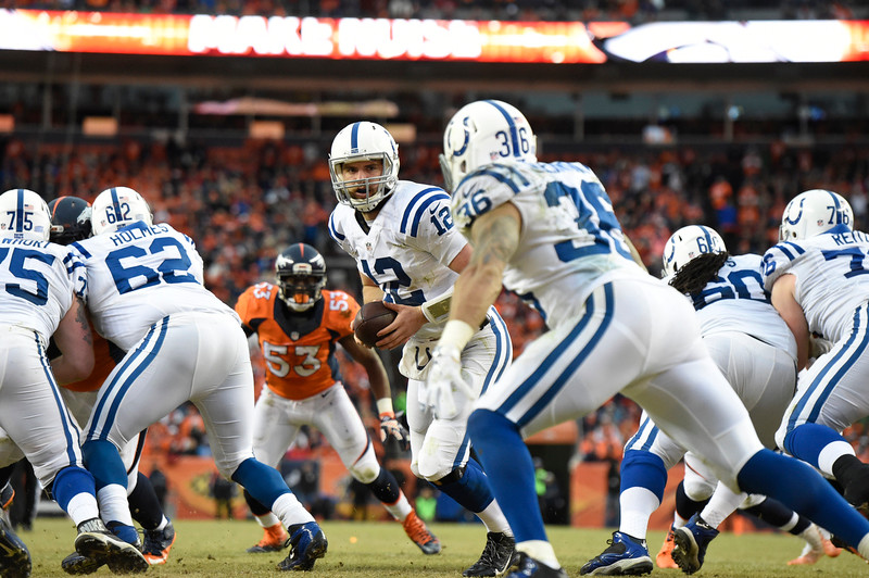 . Andrew Luck (12) of the Indianapolis Colts hands off to Dan Herron (36) of the Indianapolis Colts. The Denver Broncos played the Indianapolis Colts in an AFC divisional playoff game at Sports Authority Field at Mile High in Denver on January 11, 2015. (Photo by Joe Amon/The Denver Post)