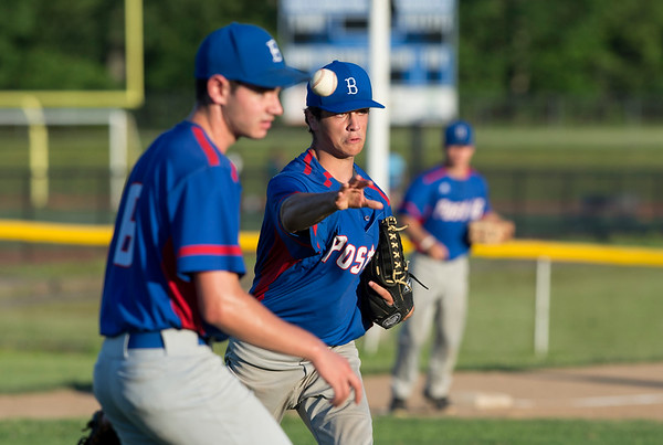 06/27/19 Wesley Bunnell | Staff Berlin Post 68 Legion baseball vs Southington Post 72 on Thursday June 27, 2019. Berlin pitcher (20) throws to first on a bunt attempt.