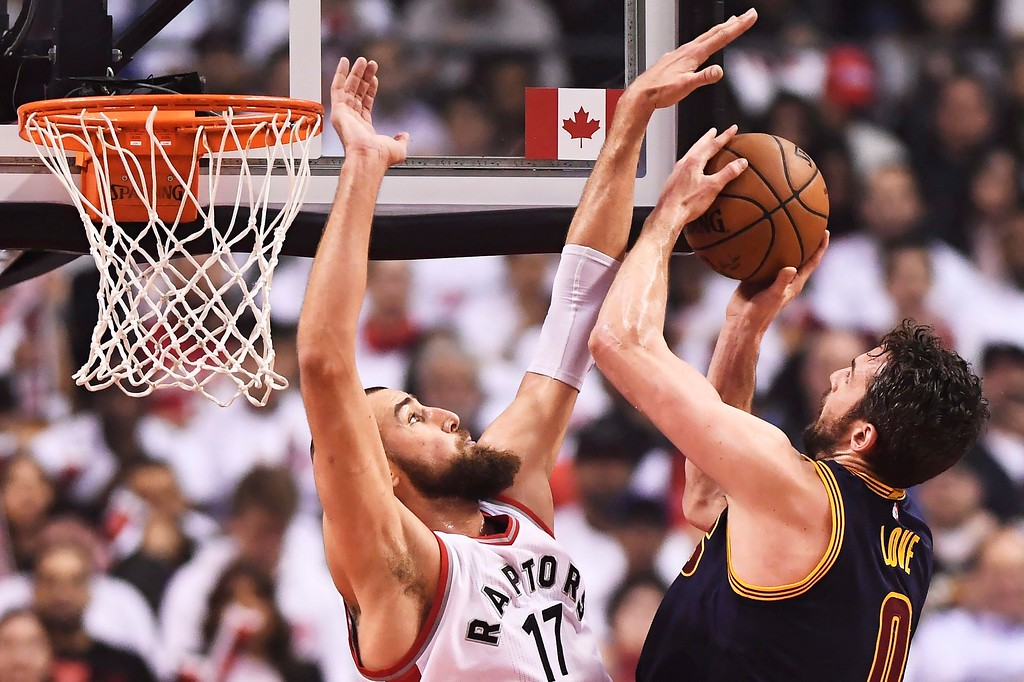 . Cleveland Cavaliers forward Kevin Love (0) shoots as Toronto Raptors center Jonas Valanciunas (17) defends during the first half of Game 3 of an NBA basketball second-round playoff series in Toronto on Friday, May 5, 2017. (Frank Gunn/The Canadian Press via AP)