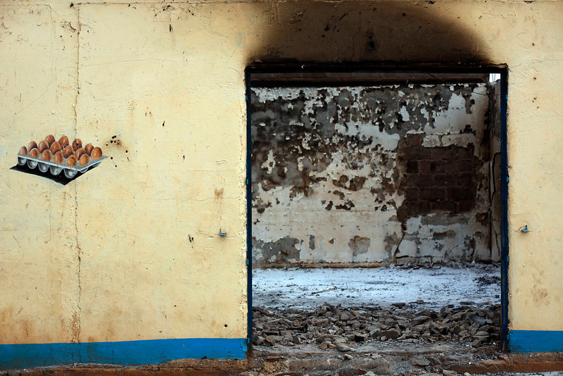 . A Muslim owned poultry shop stands looted in the Miskin district of Bangui, Central African Republic, Tuesday Feb. 4, 2014. (AP Photo/Jerome Delay)