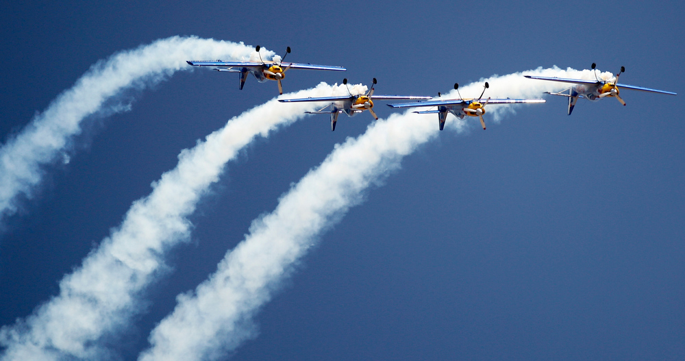 . Flying Bulls Zlin 50LX single-engine and single-seater aerobatic display team from the Czech Republic perform on the opening of the Aero India 2013 at Yelahanka air base in Bangalore, India, Wednesday, Feb. 6, 2013. More than 600 aviation companies along with delegations from 78 countries are participating in the five-day event that started Wednesday. (AP Photo/Aijaz Rahi)