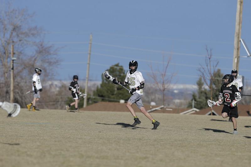 JPM0267-JPM0267-Jonathan first HS lacrosse game March 9th.jpg