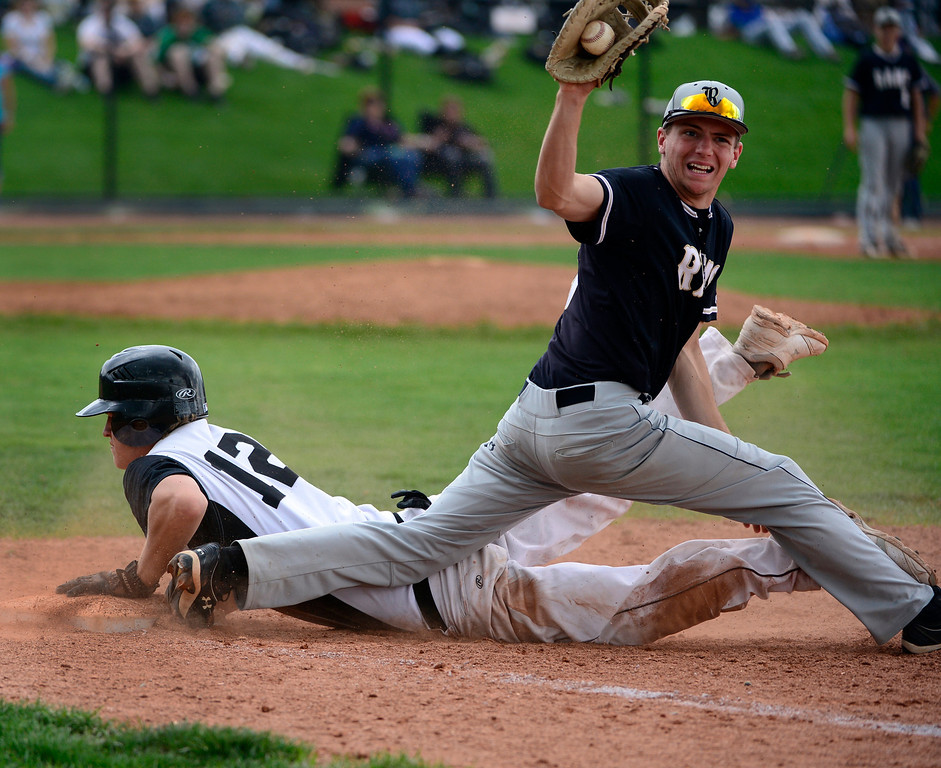 . LAKEWOOD, CO - MAY 23: Durango\'s Wyatt Wymore is safe at first even as Green Mountain\'s Andrew Abercrombie shows his catch. The Durango Demons take on the Green Mountain Rams in the 4A Baseball State Semi-Final Championships. (Kathryn Scott Osler, The Denver Post)