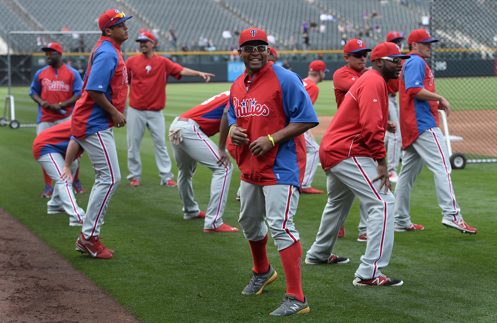 . DENVER, CO - APRIL 18: The Philadelphia Phillies warmed up before taking batting practice Friday night. The Colorado Rockies hosted the Philadelphia Phillies Friday night, April 18, 2014 at Coors Field.  (Photo by Karl Gehring/The Denver Post)