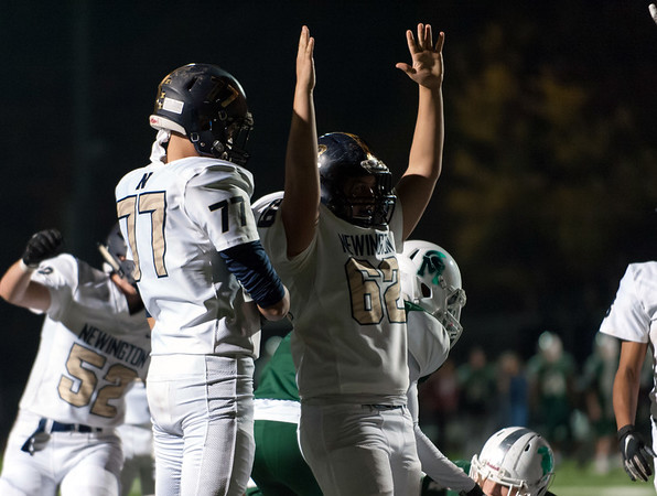 11/01/18 Wesley Bunnell | Staff Newington football vs Maloney at Falcon Field in Meriden on Thursday evening. Tymothy Sullivan (62) signals the Newington touchdown in the first half.