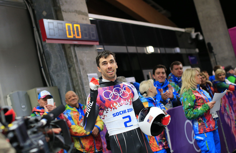 . US Matthew Antoine celebrates his bronze medal after finishing the Men\'s Skeleton Heat 4 and final run at the Sanki Sliding Center in Rosa Khutor during the Sochi Winter Olympics on February 15, 2014. (ALEXANDER KLEIN/AFP/Getty Images)