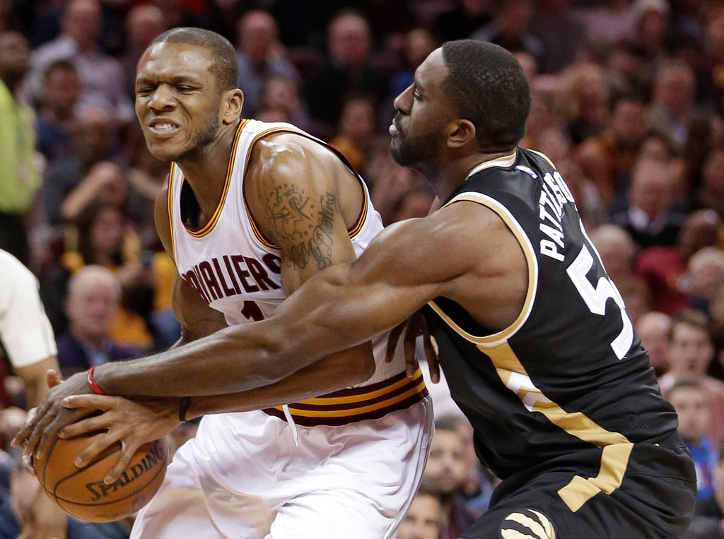 . Toronto Raptors\' Patrick Patterson, right, fouls Cleveland Cavaliers\' James Jones in the first half of an NBA basketball game, Monday, Jan. 4, 2016, in Cleveland. The Cavaliers won 122-100. (AP Photo/Tony Dejak)